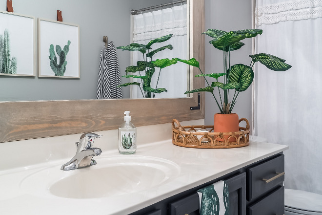 Bathroom countertop decor with rattan tray and greenery