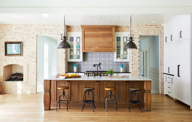 Brick Farmhouse Kitchen The kitchen back wall features hand-cut brick wall with a heavy hand troweled mortar joint Kitchen cabinets are painted Sherwin Williams Alabaster in Flat finish #Brickkitchen #kitchenbrick # FarmhouseKitchen