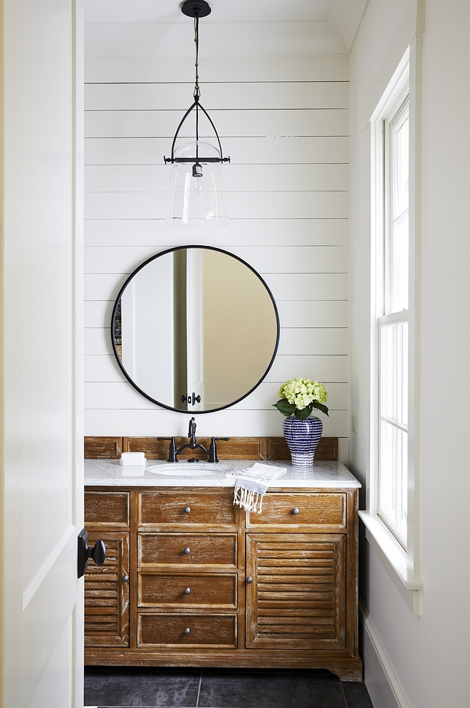 Driftwood vanity The master bathroom feels rustic and warm thanks to a pair of Driftwood vanities and shiplap See source for driftwood vanity on the blog #Driftwoodvanity