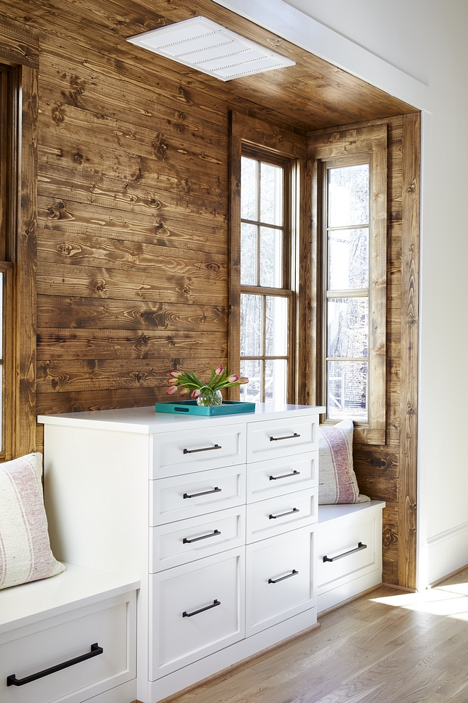 Bedroom Built-in Dresser tucked into a nook with stained shiplap walls Built in dresser features built in seats on both sides #bedroom #builtindresser #dresser #customdresser #builtindressers #windowseats #shiplap