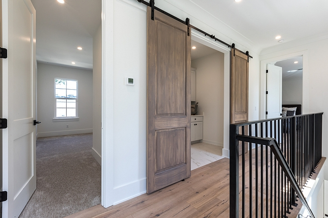 Second floor laundry room Upstairs, you will find a laundry room concealed with custom barn doors #laundrroom