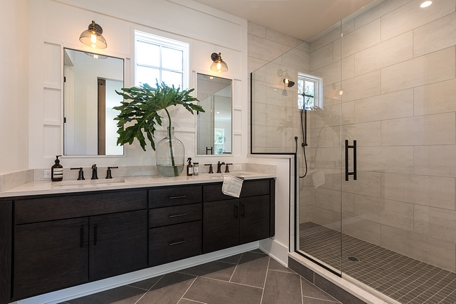 Modern farmhouse bathroom with large shower with 12x24 tile, herringbone floor tile, floating bathroom vanity and vertical board and batten accent wall #masterbathroom #boardandbatten #modernfarmhousebathroom #floatingvanity