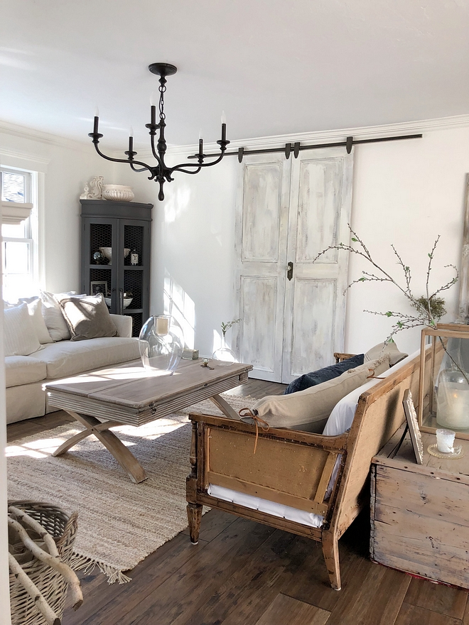 Distressed Barn Door Hides the Tv in this living room Distressed Barn Door #DistressedBarnDoor