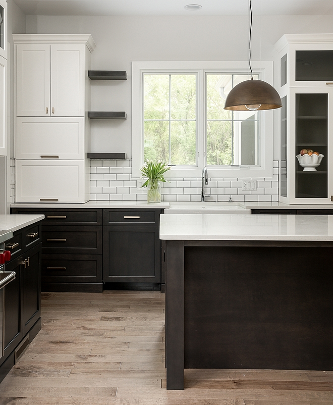 Two toned kitchen with white upper cabinets and dark stained lower cabinets The upper cabinets are painted in White Dove OC 17 Benjamin Moore #twotonedkitchen #whiteuppercabinet #WhiteDoveOC17BenjaminMoore