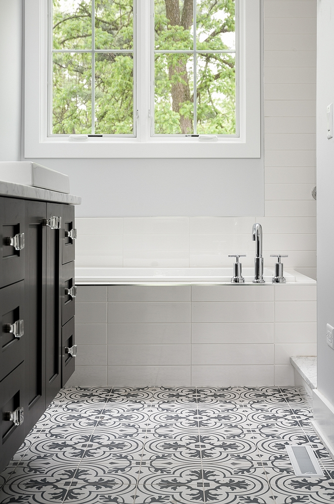 Affordable bathroom tile combination ideas The tub is surrounded by 4x16 white subway tile