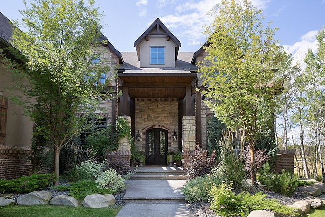 Curb appeal This home has a very grand, but inviting curb appeal with large double iron front doors and a front veranda #curbappeal