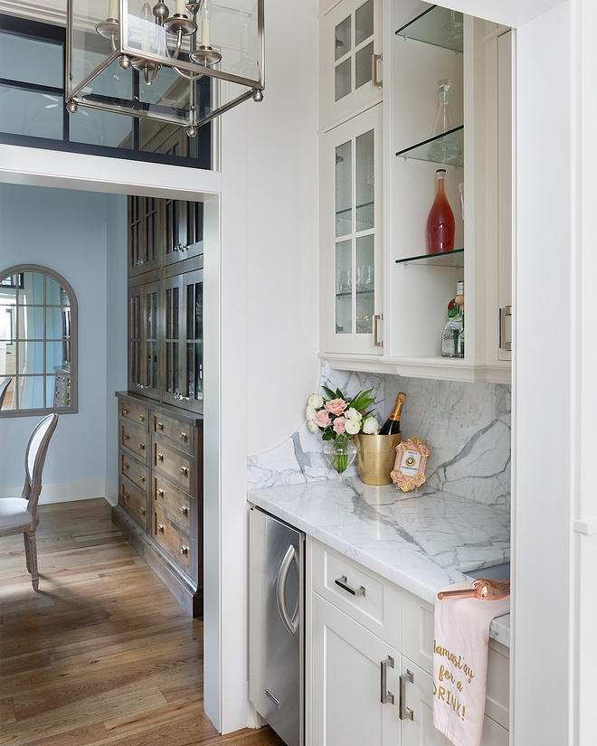 Butlers pantry The butler's pantry is located between the dining room and kitchen, and includes a sink, glass / bottle storage and an icemaker #Butlerspantry