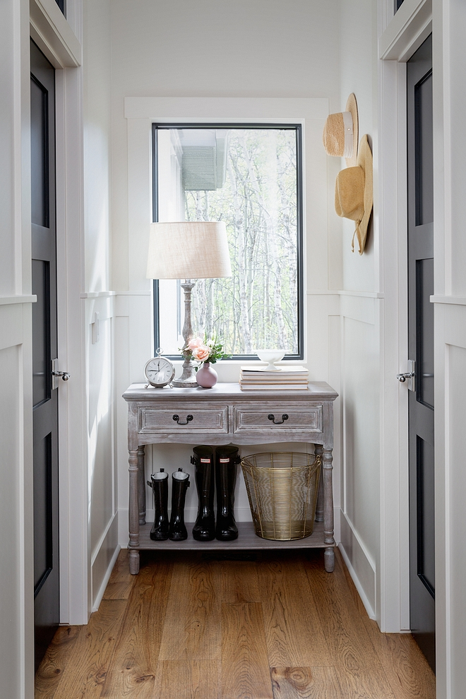 This hallway lets tons of light in, and connects the home from garage to great room. I found the perfect small console to fit this space for ditching keys and sunglasses when you get home #hallway #console #consoletable