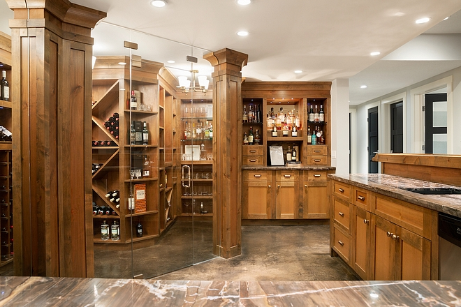 Wine Room Alder Cabinetry Wine Room This amazing 650+ bottle wine room and bar is definitely a focal point in the basement #WineRoom #Basement