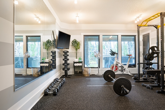 Home Gym The mounted TV is great for watching spin classes or YouTube workout videos – it's like having a built-in trainer #homegym
