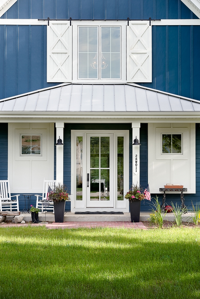 Front Door Front Porch A glass front door with sidelights is flanked by two windows with custom board and batten trim Front Door Front Porch #Boardandbatten #trim #exteriortrim #FrontDoor #FrontPorch