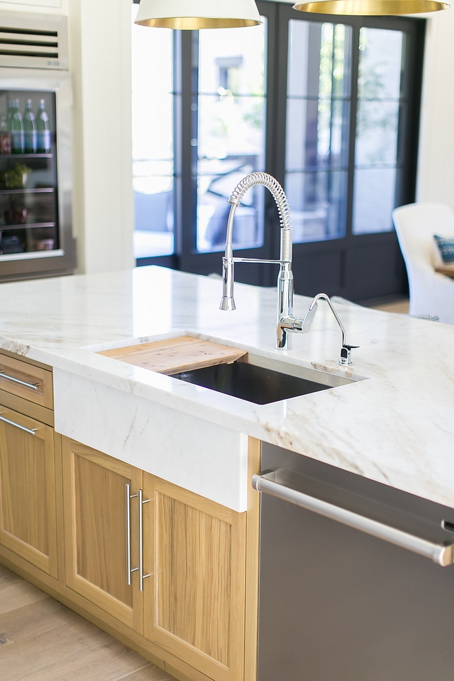 "Kitchen Countertop is Calacutta Umber marble - Honed Kitchen Sink is stainless steel but the designer added a marble slab to add the ""apron sink"" look without having to compromise on having a more durable stainless steel sink #kitchen #kitchencountertop #kitchensink"