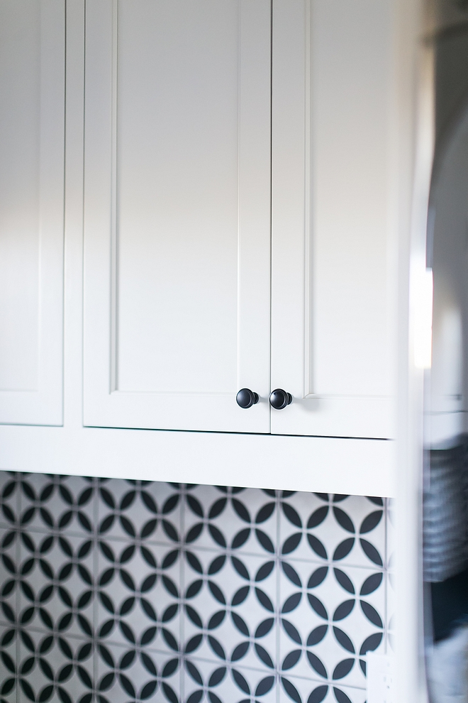 Benjamin Moore White Dove cabinet with black matte hardware