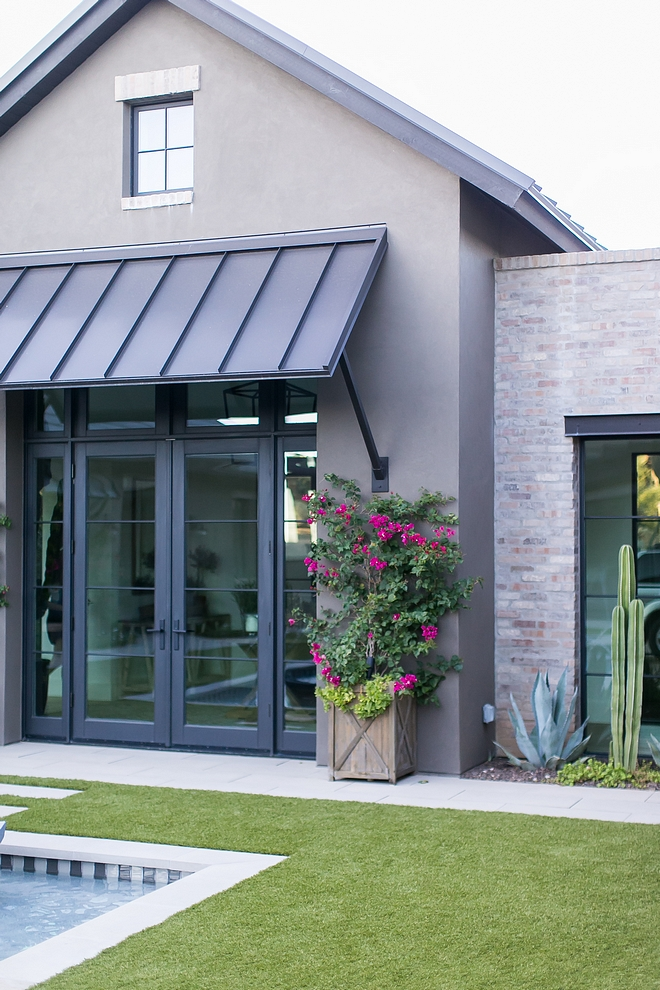 Exterior Grey stucco with Brick, metal roof and black steel doors and windows Exterior brick is General Shale Ironworks