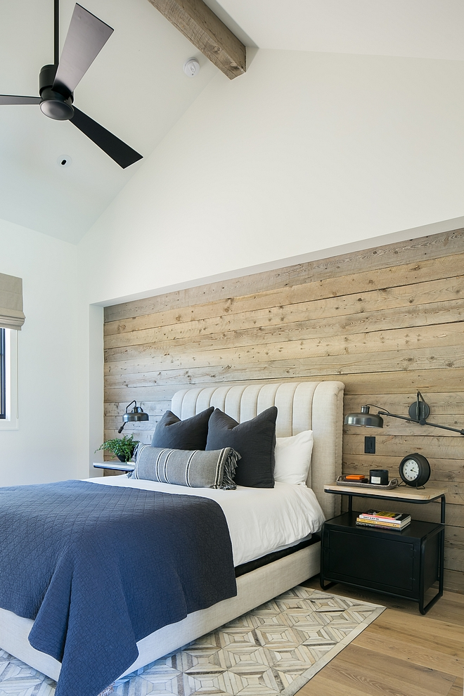 This room was designed for our son who is in college. I wanted the room to have a masculine feel that would be neutral enough to double as guest room down the road. Reclaimed barn wood was installed to bed alcove and industrial style wall lamps were added