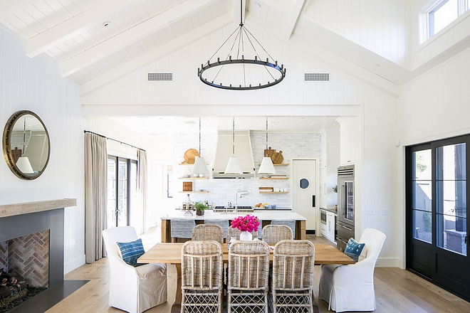 The large farm table divides the kitchen from great room and serves as our casual dining room. I wanted fireplace placed in this space to further define this room