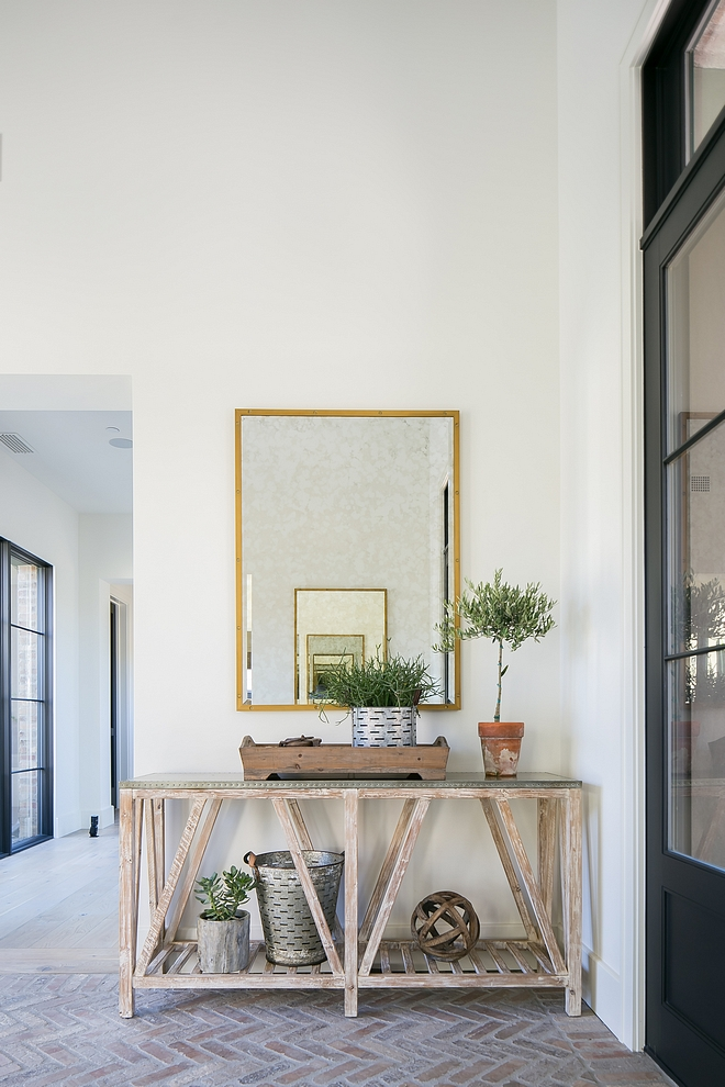 Modern Farmhouse Foyer with reclaimed wood console table and organic decor Modern Farmhouse Foyer #ModernFarmhouse #Foyer #reclaimedwood #consoletable #decor