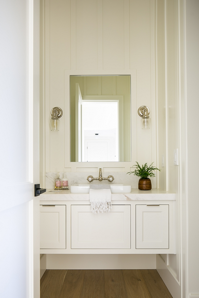Benjamin Moore OC17 White Dove This stunning powder room features board and batten walls and a floating vanity Paint color is Benjamin Moore OC-17 White Dove #boardandbatten #paintcolor #boardandbattenPaintcolor #BenjaminMooreOC17WhiteDove