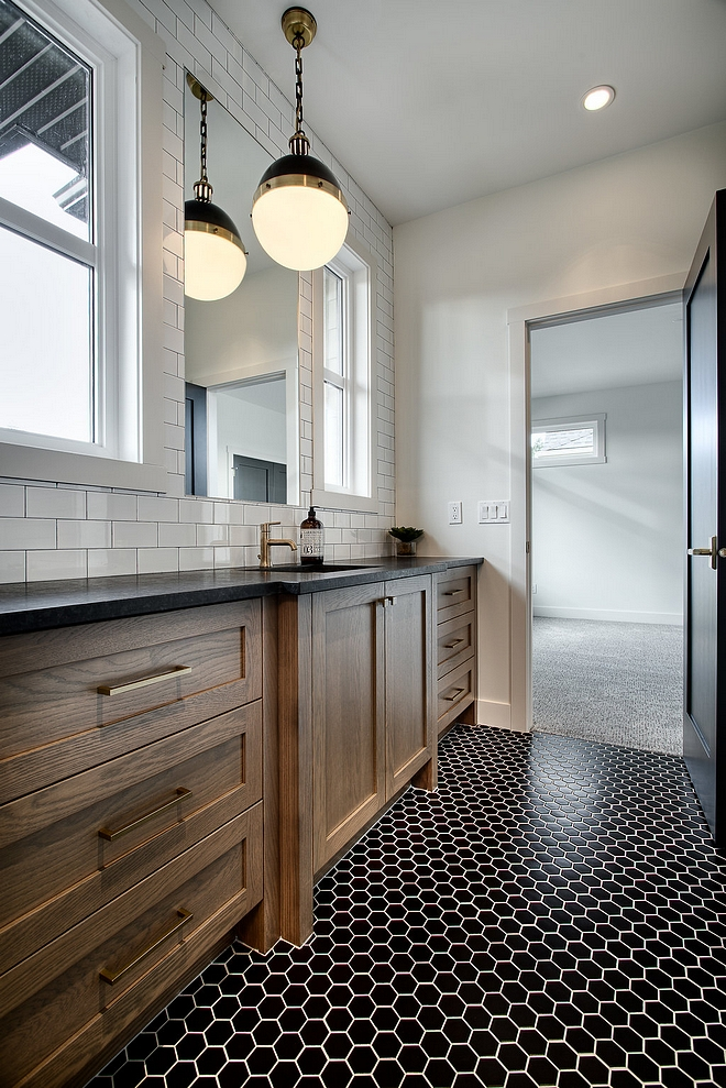 Modern farmhouse bathroom with a large Rough sawn White Oak vanity, leathered black granite countertop, Hicks pendants and black hex mosaic tile #modernfarmhousebathroom #bathroom #largevanity