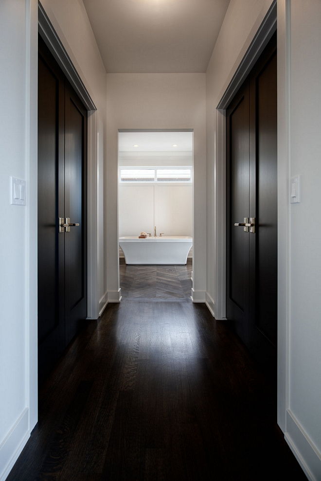 A hall leads to separated his and hers closets and to the master bathroom