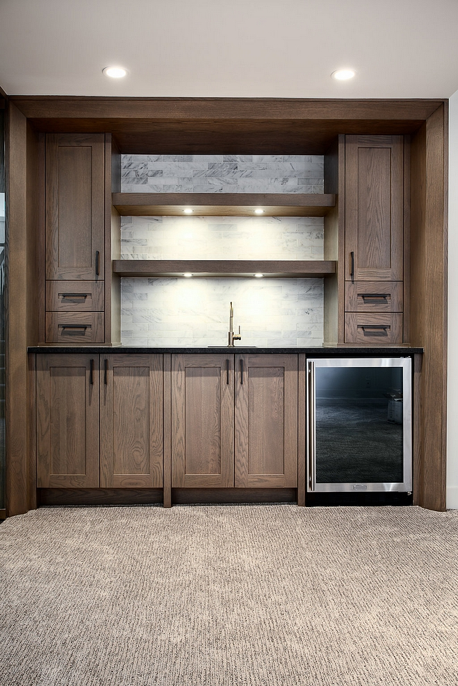 white Oak Wet Bar Basement with white Oak Wet Bar, white marble backsplash tile and black granite cointertop #Basementbar #whiteOak #WetBar #Basement