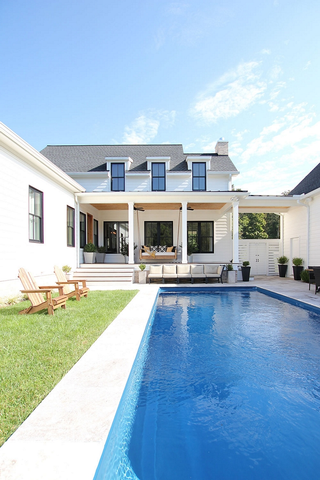 """Modern Farmhouse Pool The pool area is tucked away between the garage and the house, which gives us lots of privacy. To add more """"modern"""", we decided on a simple rectangular shape. It's surrounded by 2′ x 2′ travertine tiles #moderngfarmhousepool #modernfarmhouse #pool"""
