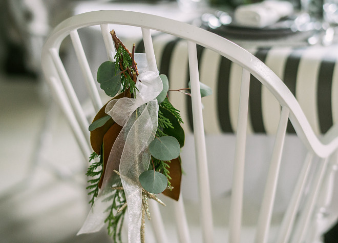 Christmas Chair Decor Natural Christmas decor behind chair Christmas Chair DecorFresh greens are always my go to when styling for the Holiday yes, they can be more work and yes, they do drop as the season winds up but for me… there is no substitute! Here a small posy of cedar, seeded eucalyptus and a magnolia tip are tied with ribbon on the chair backs #ChristmasChairDecor #NaturalChristmasdecor