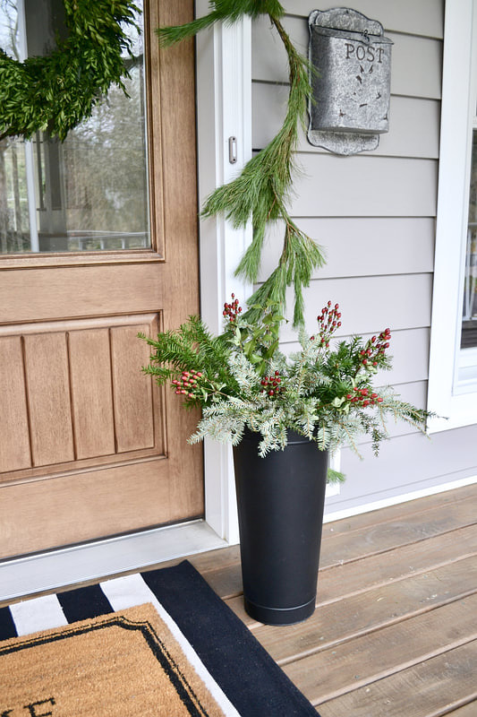 Christmas Planter Decor I filled a black container with live greenery and red berries Easy and affordable Christmas Planter Decor Ideas #ChristmasPlanter #ChristmasPlanterDecor