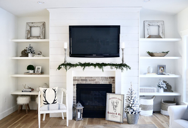 Family Room Christmas decor In our family room, I used live cedar garland across our mantle and added accents such as a white flocked trees and an antler pillow from a local shop #familyroom #Chirstmas #Christmas
