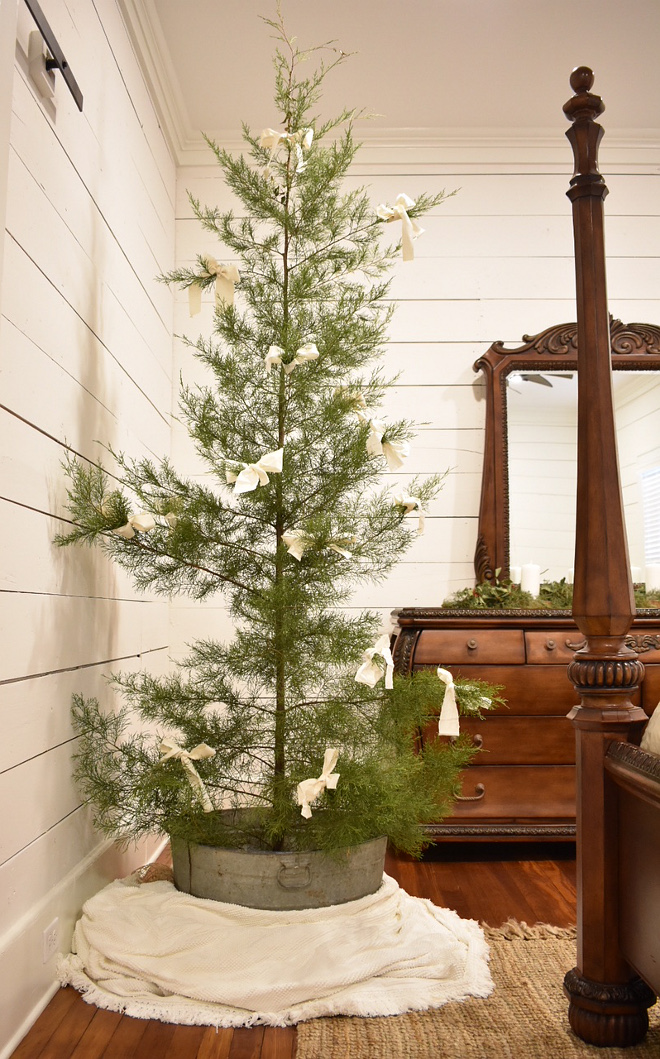 Natural Farmhouse Christmas tree In order to find the perfect greenery and trees for the rest of the cottage, I did traipse through the woods and cut an abundance of cedar, pine and boxwood #NaturalFarmhouseChristmastree #NaturalChristmastree