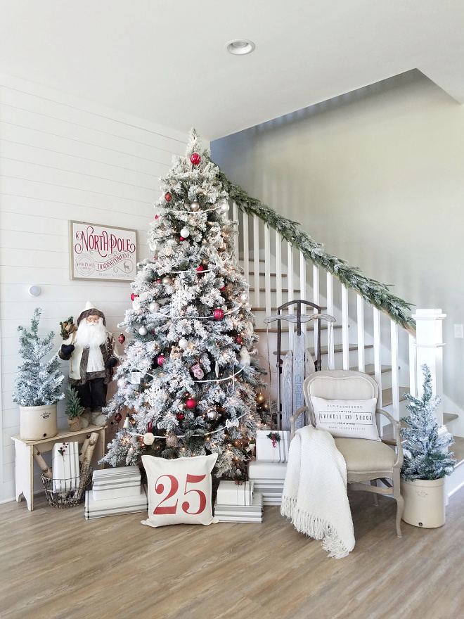 Staircase Christmas Decor Wall paint color is Sherwin-Williams Agreeable Gray