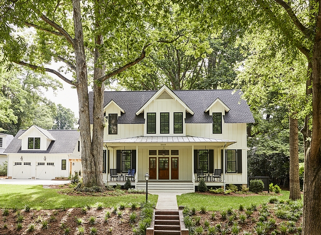 Southern-style Farmhouse Southern-style Farmhouse exterior with board and batten siding metal roof and black windows Southern-style Farmhouse Southern-style Farmhouse Southern-style Farmhouse #SouthernstyleFarmhouse #SouthernFarmhouse