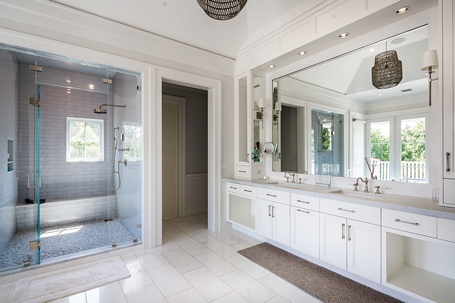 The master bathroom features a very spacious shower and an extensive cabinetry #bathroom #spaciousshower #shower #bathroomcabinetry