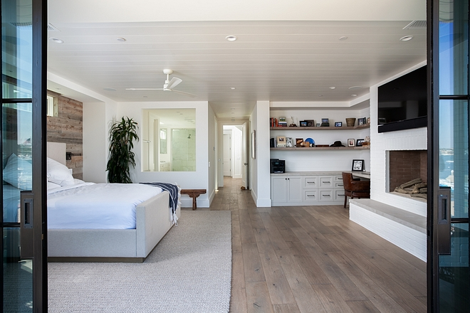 Beach House Upstairs you will find a stunning master bedroom with a dreamy ocean view! Ceiling treatment is paint grade nickel slot siding Beach House #BeachHouse