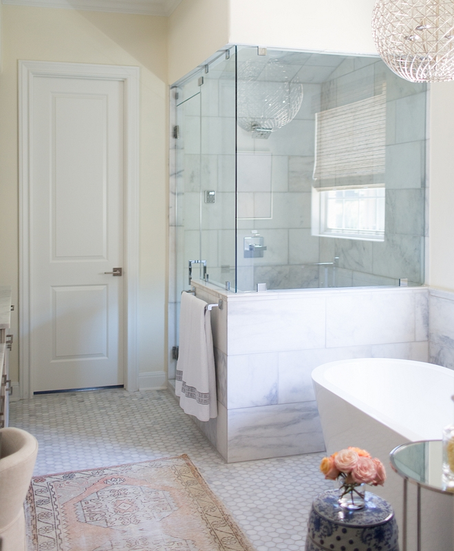 "Large Shower Tile 12""x24"" Large format marble tile A frameless glass enclosure and chrome details keep the master bathroom feeling fresh and modern Large Shower Tile 12""x24"" Large Tile #LargeShowerTile #LargeTile"