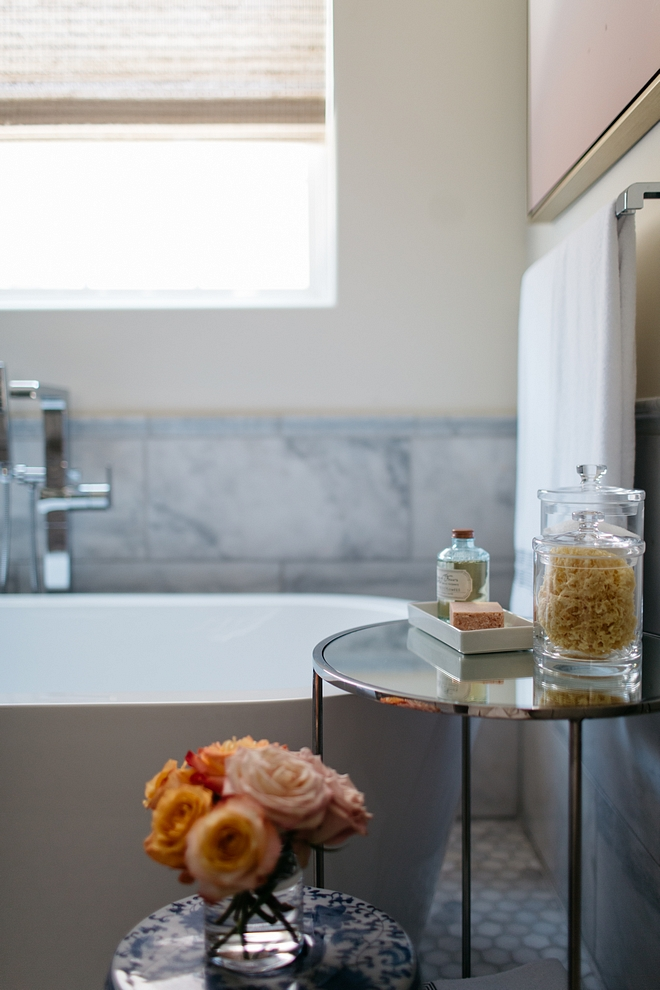 Bathroom tub decor Table decor ideas Bathroom styling How to style a bathroom like a designer The designer added a round side table near tub for accents Bathroom tub decor Bathroom tub decor #Bathroomdecor