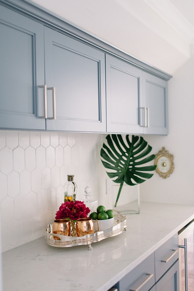 Butler's pantry with blue grey cabinets, Sherwin Williams Storm Cloud, marble-looking countertop and elongated hexagon tile backsplash #SherwinWilliamsStormCloud #blugrey #cabinet #butlerspantry