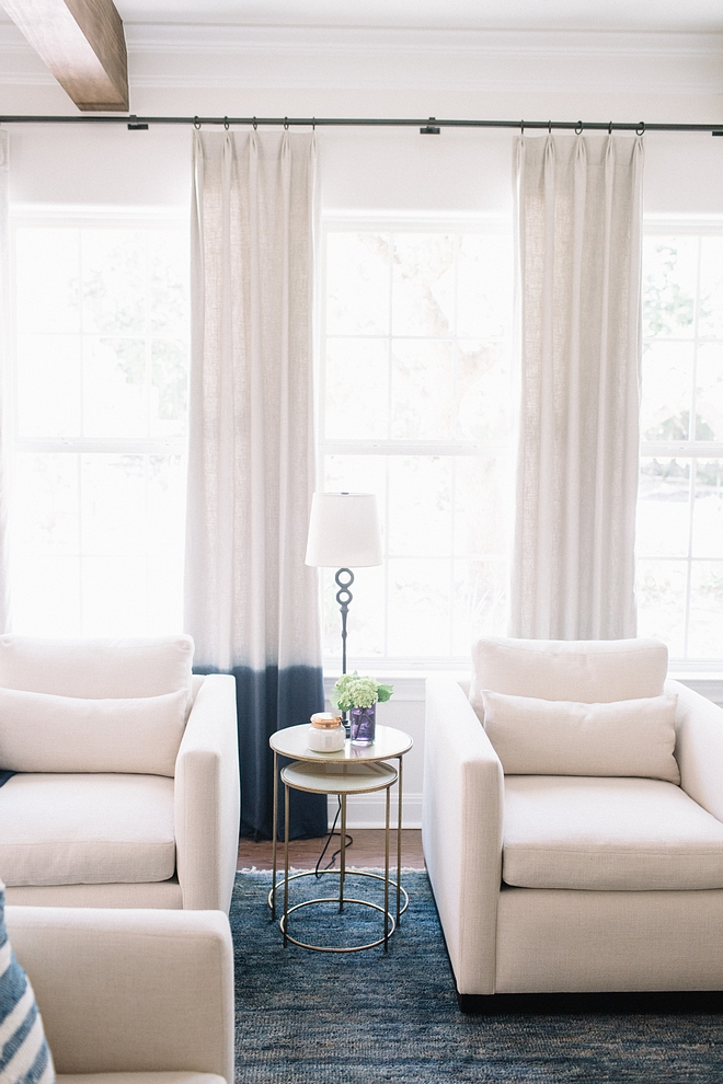 White linen chair Accent chairs Pair of white linen chairs against Blue Ombre dipped linen draperies and blue jute rug See sources on Home Bunch #Whitelinenchair #Accentchairs