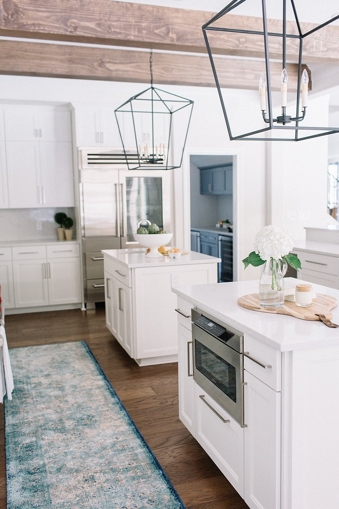 """Prep kitchen island prep-island Islands have one functional drawer and one functional cabinet (24""""l) on each long side, with millwork on face of other sides only. Microwave drawer in breakfast side island (sink in other) #prepisland #kitchenisland #prepkitchenisland"""
