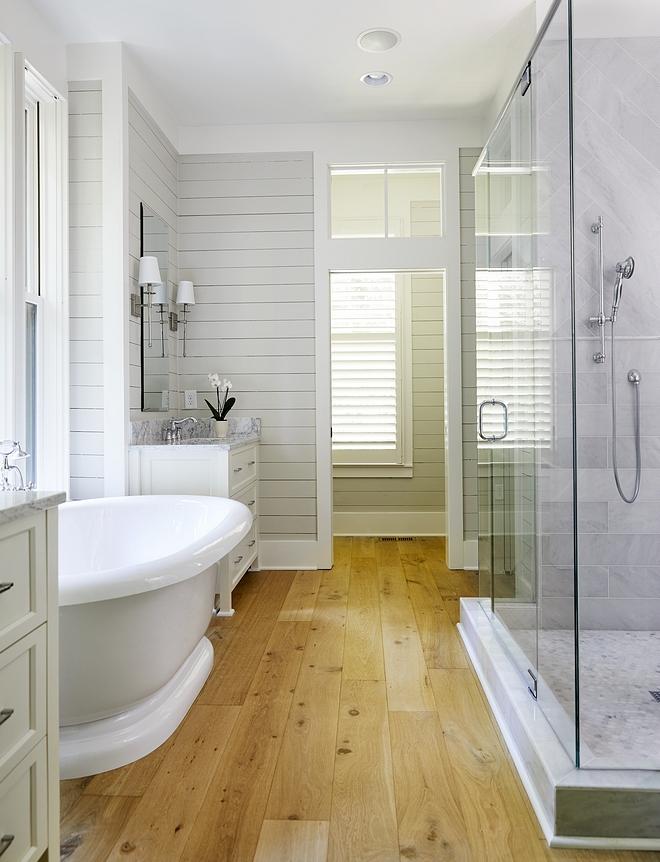 Bathroom hardwood floor Best hardwood flooring for bathrooms A low-sheen hardwood flooring adds warmth to this beautiful master bathroom #Bathroomhardwoodfloor #Bathroomhardwoodflooring #Bathroom #hardwoodflooring