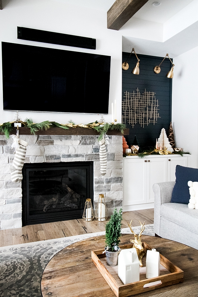 Simple Mantel Christmas Decor Farmhouse style Mantel Christmas Decor with striped knit stockings and Christmas garland #Christmasgarland #Christmasmanteldecor #manteldecor