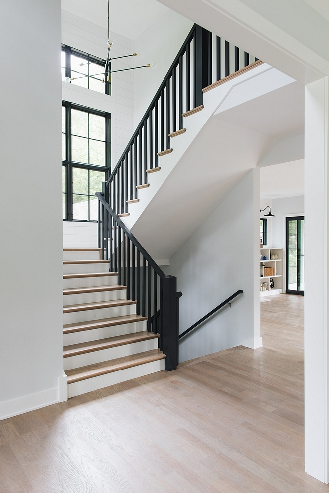 Black Railing Staircase Modern farmhouse staircase black railing black spindles shiplap The staircase features black spindles and railings to match the black windows #BlackRailing #Staircase #Modernfarmhousestaircase #blackrailingstaircase #shiplap