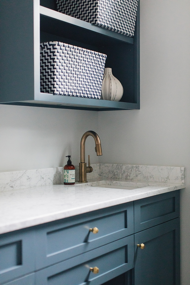 Blue cabinet with White Carrara countertop Blue cabinet whith white marble countertop , brass hardware and brass faucet #Bluecabinet #whitemarble #countertop