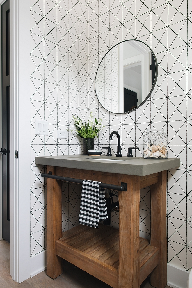 Chunky wood vanity This chunky wood vanity with concrete countertop brings a rustic feel to this monochromatic powder room with black and white geometric wallpaper #chunckywoodvanity #chunckywood #blackandwhitegeometricwallpaper #blackandwhitewallpaper #geometricwallpaper