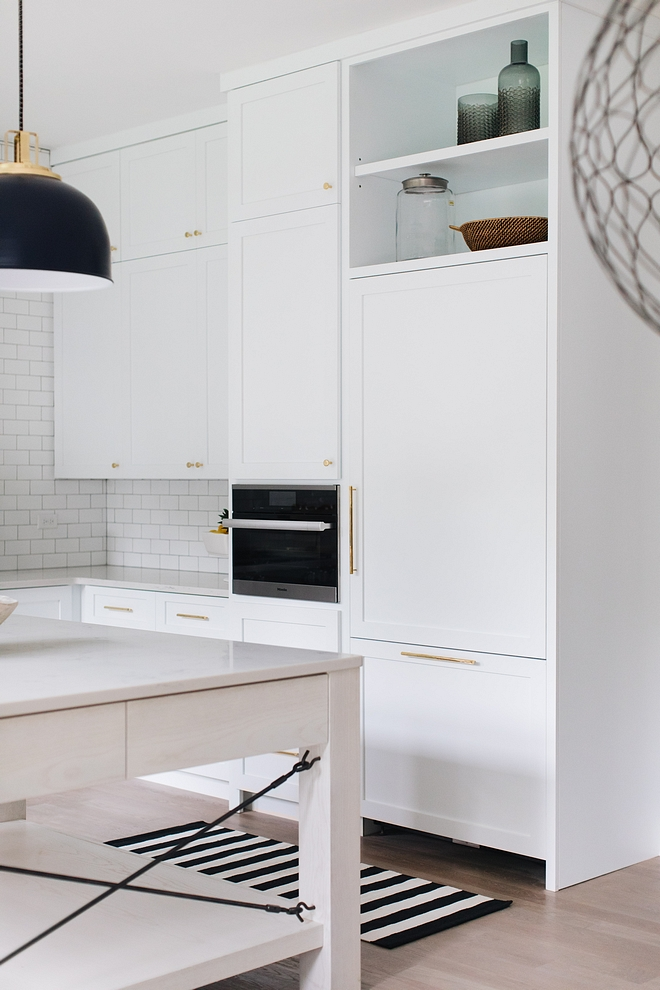 White Kitchen Cabinet Details Maple Shaker-style kitchen cabinet painted in Sherwin Williams Extra White, which is one the crispest whites you can get #WhiteKitchen #whitekitchenCabinet #cabinet #Shakerstylekitchencabinet #SherwinWilliamsExtraWhite