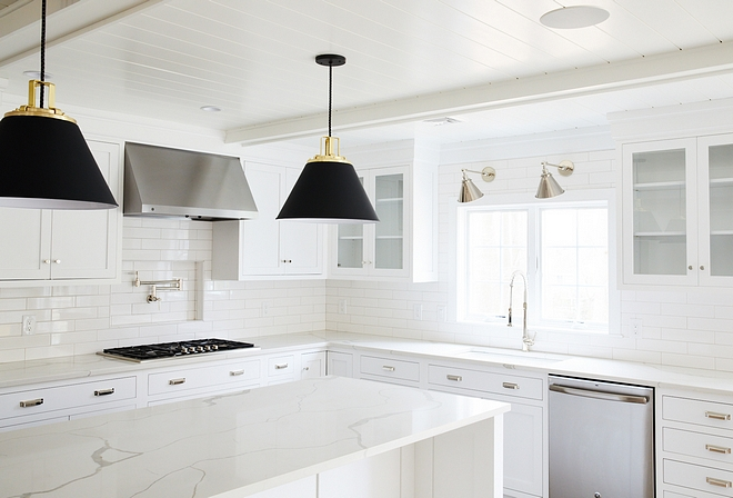 Gut Kitchen Renovation Rearranging mostly of the main floor, allowed the designer to add an open-concept kitchen with crisp white cabinets and a large kitchen island #kitchenrenovation #kitchen #renovation
