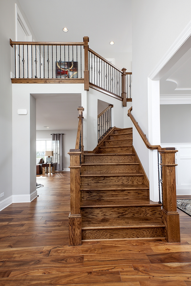 Oak Staircase Treads and posts A custom Oak staircase adds warmth and architectural interest to this home #Oakstaircase #Staircase
