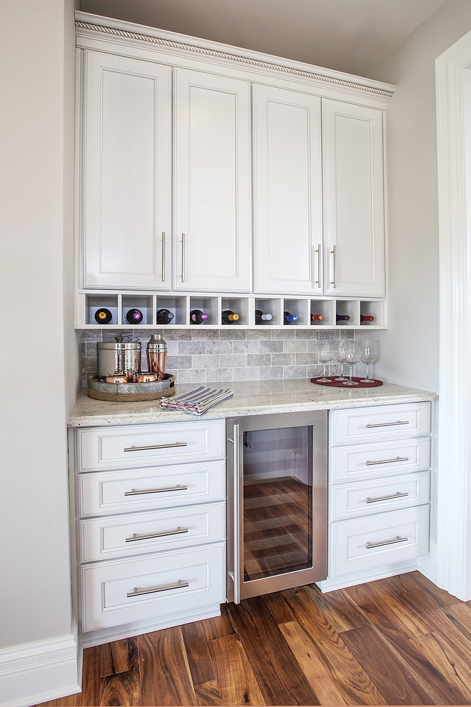 Traditional Butlers Pantry The butler's pantry features a beverage center and white granite countertop #TraditionalButlersPantry #ButlersPantry