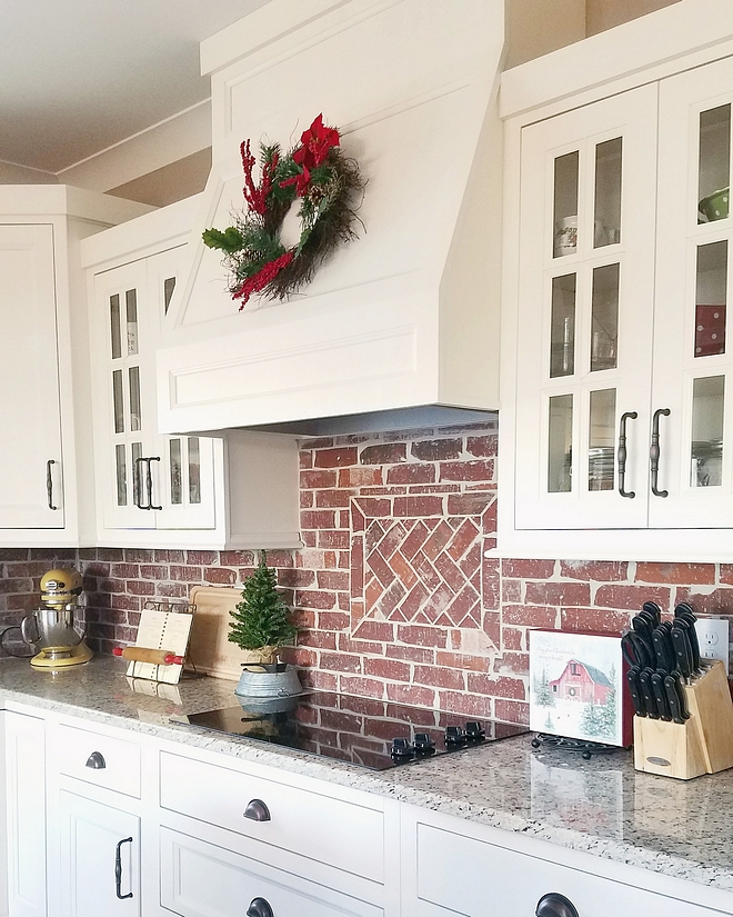 White kitchen with brick backsplash The shaker style cabinets are recessed - painted SW 7008 Alabaster by Sherwin Williams White kitchen with Chicago brick backsplash #Whitekitchen #brickbacksplash