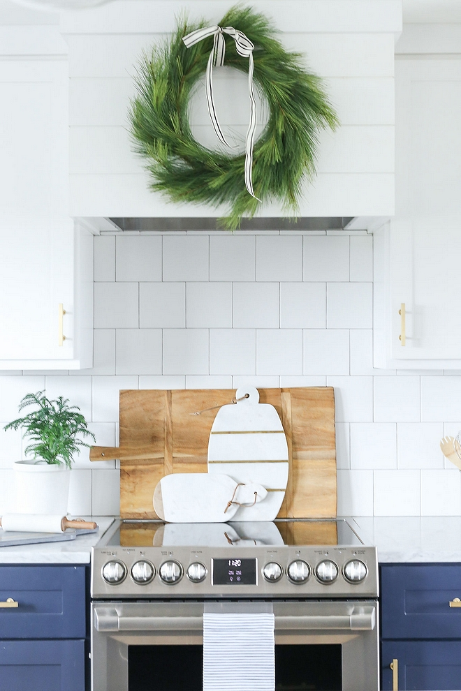Two-toned kitchen paint color two-toned kitchen features a custom shiplap hood and shaker cabinets. Lower cabinets and island are painted in Benjamin Moore Hale Navy and upper cabinets are Benjamin Moore OC-152 Super White